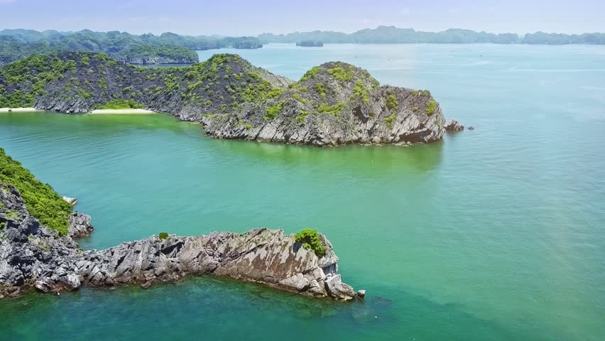 aerial view wonderful azure bay with large and small rocky islands of whimsical shape in famous national park Ha Long