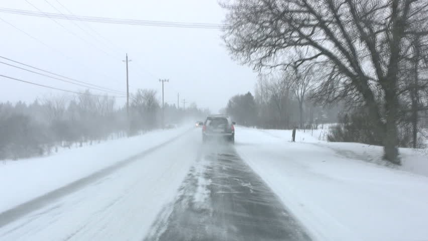 Driving On A Rural Road During A Snow Storm