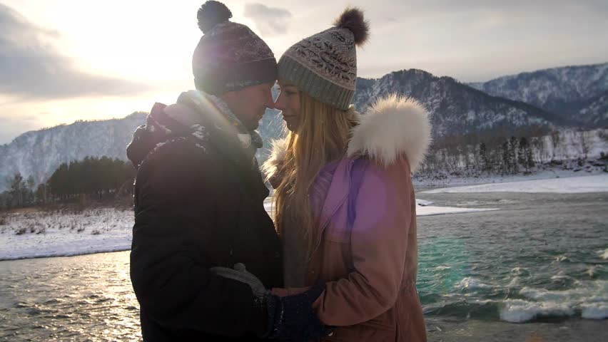 Young traveling couple standing in mountains | Shutterstock HD Video #33800950