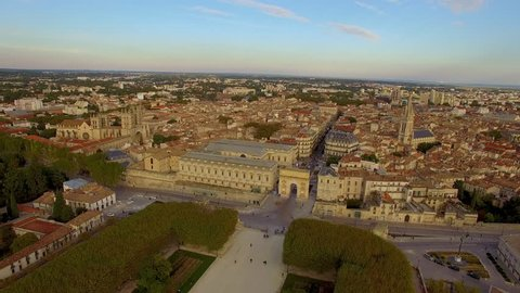 Wide aerial shot circling Montpellier's historical Peyrou district