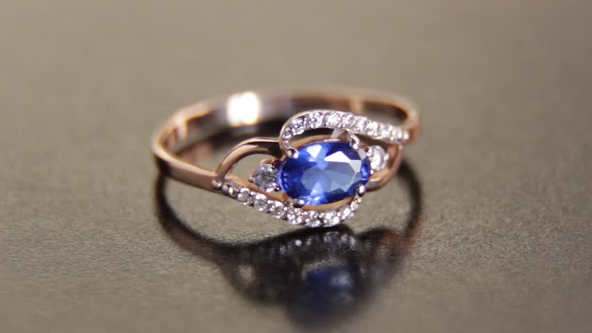 Jewelry Gold Ring Inlaid With Glittering Jewels Sold In The Store