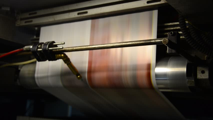 offset print press hit set roll paper goes through the rollers and is read by