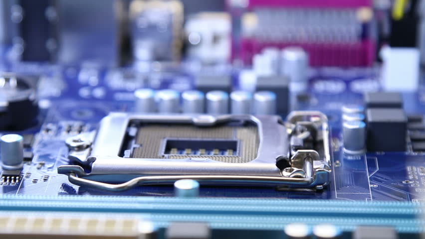 Installing the CPU cooler on the motherboard socket. | Shutterstock HD Video #33847420