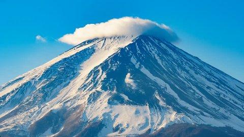 Cloud-capped moving around the summit of Mt. Fuji or Mount Fujisan or Fujiyama mountain. View from Fujikawaguchiko city, Yamanashi prefecture, Japan. (4K Time lapse)