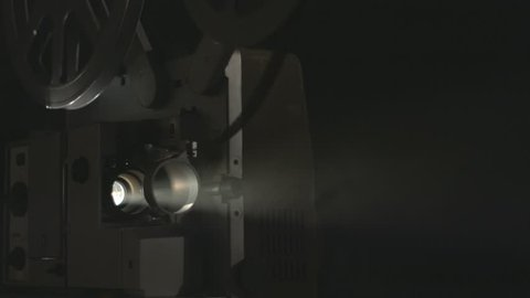 16 mm vintage film projector start rolling and stop
