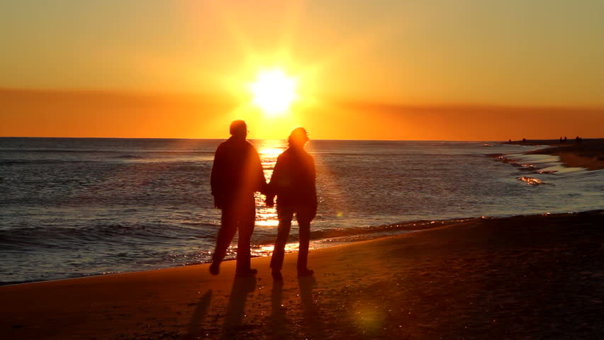 Couple Walking Along Summer Beach At Sunset Stock Footage ...
