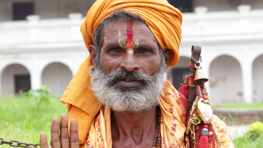 KATHMANDU, NEPAL - SEPTEMBER 29, 2016 : Portrait Sadhu at Pashupatinath Temple in Nepal. Sadhu is a holy man, who have chosen to live an ascetic life and focus on the spiritual practice of Hinduism.