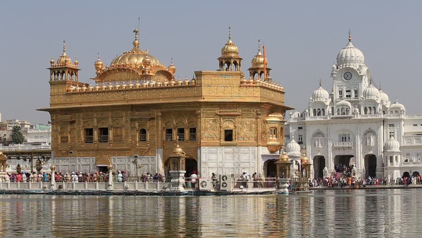 AMRITSAR, INDIA - SEPTEMBER 29, 2014: Unidentified Sikhs and indian people visiting the Golden Temple in Amritsar, Punjab, India. Sikh pilgrims travel from all over India to pray at this holy site.