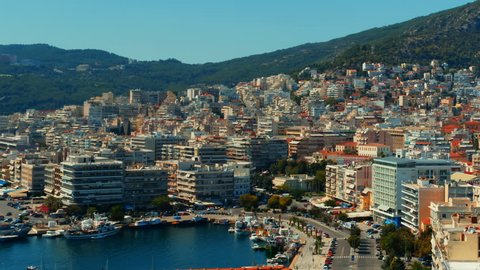 Aerial establishing shot of the city of Kavala in Greece. Kavala is the main seaport of eastern Macedonia