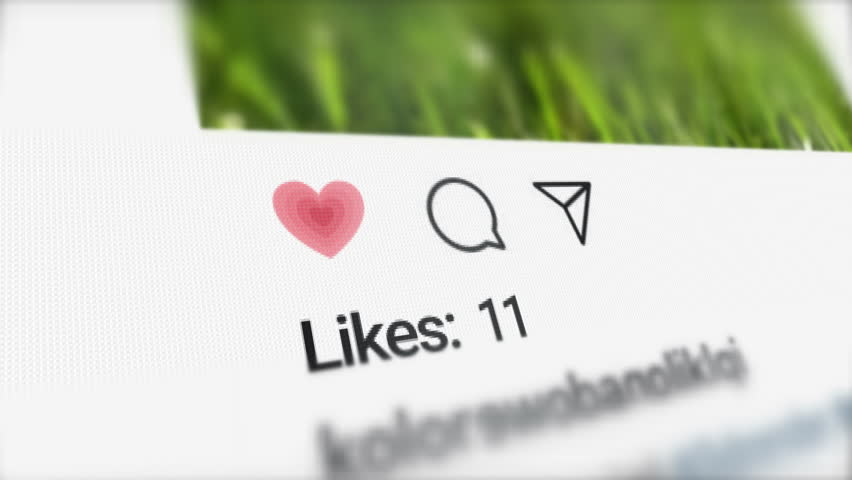 London / UK - Dec 14 2018: Editorial Animation of the New Post on Social Media and Increasing Likes Counter on the LCD screen. Close up to Like, Comment and Send Icons. Successful Instagram Post.