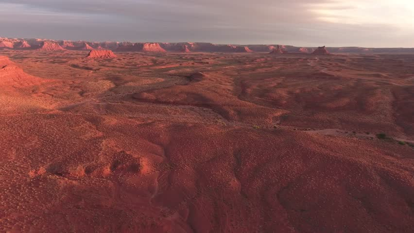 Amazing drone aerial video of the valley of the gods and monument valley at sunrise and sun set magic hour on the border of arizona and utah  | Shutterstock HD Video #33938560
