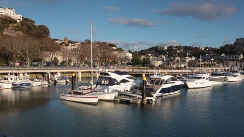 Slow pan of sailing boats and yachts in Torquay, UK