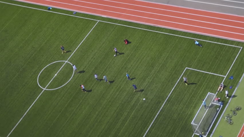 A modern beautiful football field where teenagers play football. It is located in a new residential neighborhood near the school. Top view #33963610