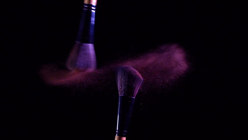 Slow motion of Cosmetic brush with violet color cosmetic powder spreading on black background   Shutterstock HD Video #33991960