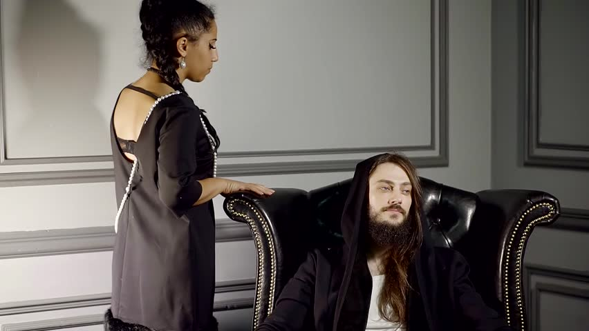 Pretty arabian woman is approaching to man sitting on a chair , smelling perfume with pheromones | Shutterstock HD Video #34019650