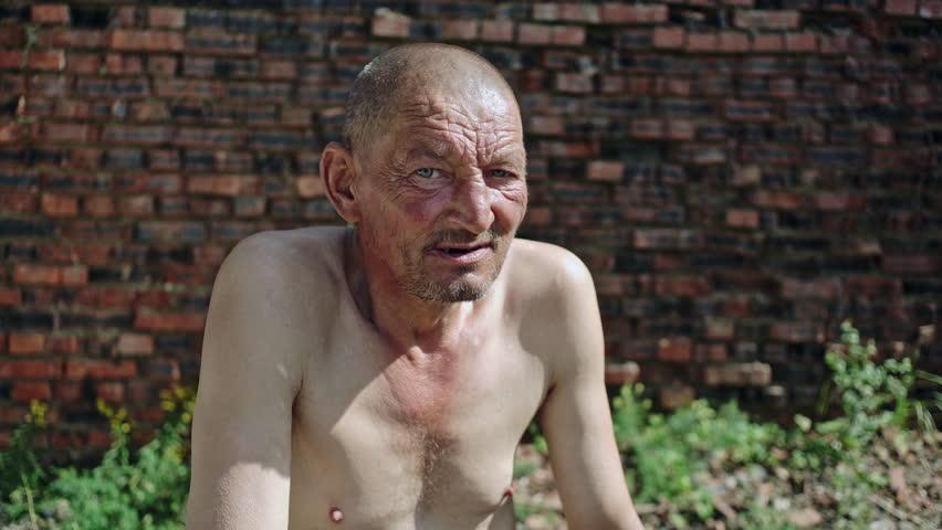 Homeless senior man in sunlight | Shutterstock HD Video #34027570