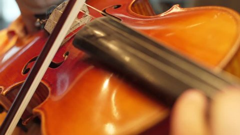 Violinist playing the violin in the orchestra slow motion