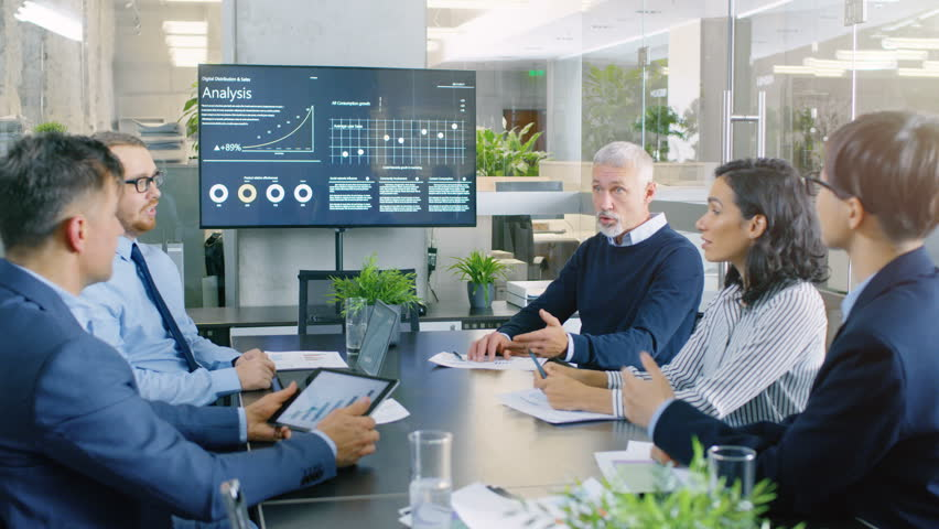 Board of Directors Has Annual Meeting, Diverse Group of Business People in the Modern Conference Room Discuss Statistics and Work Results.   | Shutterstock HD Video #34080130