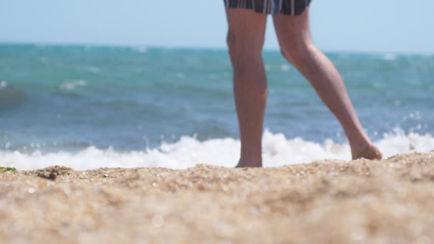 Close up of man's feet walking along the sandy beach of the sea, slow motion. 1920x1080 | Shutterstock HD Video #34126300