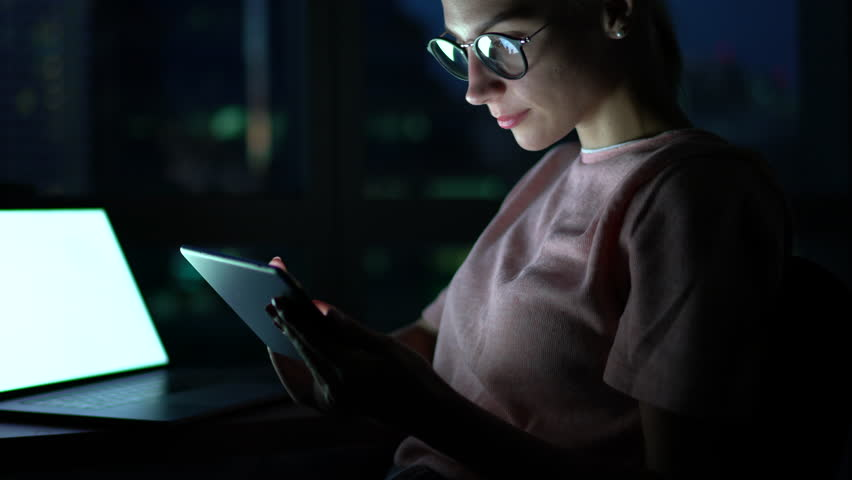 Female excited with achievement playing online game late at evening on tablet, overjoyed successful hipster girl happy about getting good news on email accomplished project before end deadline | Shutterstock HD Video #34126690