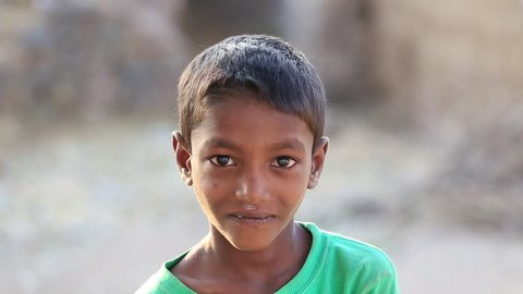 MANDU, INDIA - FEBRUARY 03, 2017 : An unidentified Indian poor children on the street . Poverty is a major issue in India