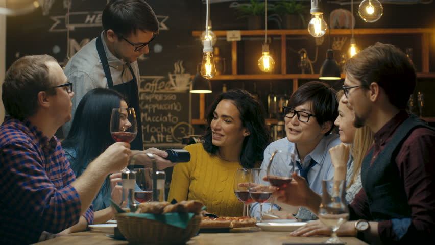 In the Bar Waiter Holds Card Machine and Beautiful Woman Pays for Her Order with Contactless Credit Card. She's Surrounded by Friends They all Have Great Time.  | Shutterstock HD Video #34161190