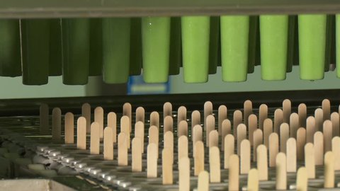 Fruit ice cream in green color. Ice cream factory. Automated production of ice cream. Ice cream production line.
