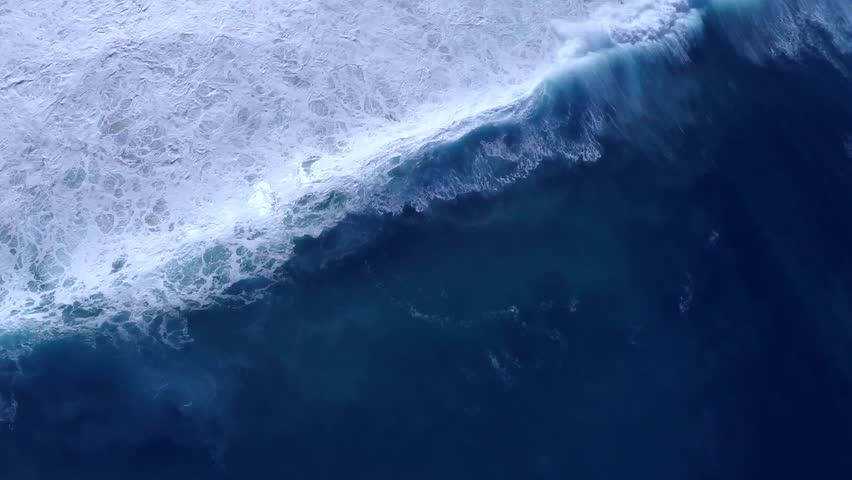 Slow motion fly over disturbed ocean water surface, loopable. (HD, high definition 1080p, seamless loop). Impressive background for movie, aerial view, cycled sea surface shot with static cam. | Shutterstock HD Video #34267030