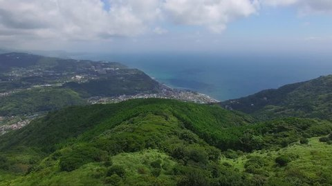 Aerial View / Drone Over The Top of Green Mountains and Ocean View, Japan