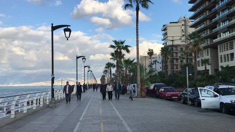 Beirut, Lebanon - 12.25.2017: General view of people strolling along the seaside corniche boulevard.