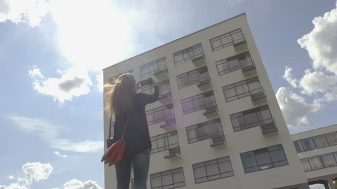 Dessau-Rosslau / Germany - 09.05.2017: Girl is taking photo of the Bauhaus building in the sunny day