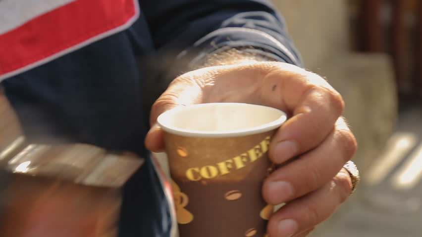 Male selling coffee in the street, small business, national warm hospitality