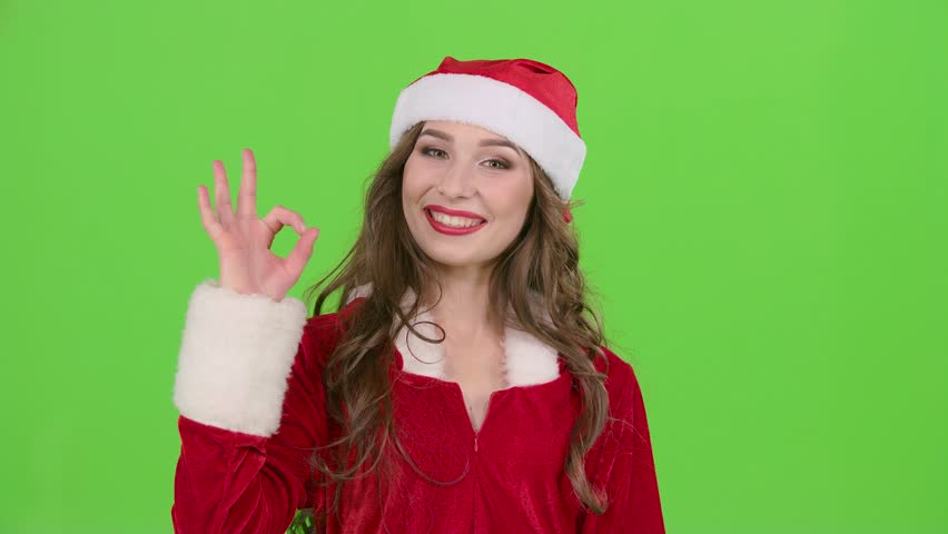 Girl in the red suit of the snow maiden winks and shows her finger ok. Green screen. Close up. Slow motion | Shutterstock HD Video #34395250
