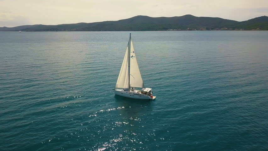 Yacht sailing on opened sea. Sailing boat. Yacht from drone. Yachting video. Yacht from above. Sailboat from drone. Sailing video. Yachting at windy day. Yacht. Sailboat. | Shutterstock HD Video #34396450