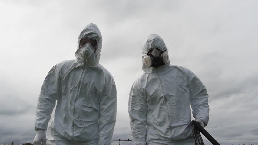 two man in uniform carrying lethal chemical product