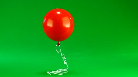 red balloon on a green background