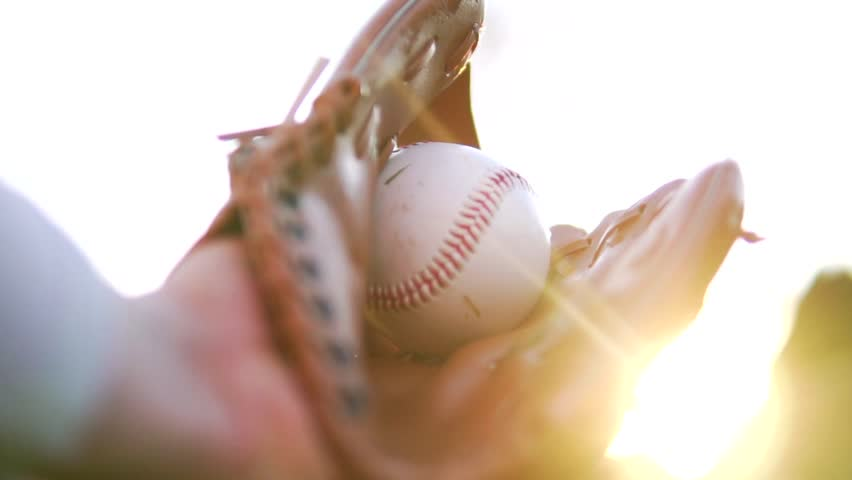 Cinematic Baseball Catch Through Sunshine In Fielder's Glove, Slow Motion. Outdoor Sports And Exercise.