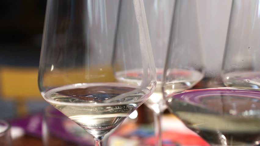 A glass of prosecco is filled by producing bubbles and foam. Sparkling white wine in a glass to toast to a celebration