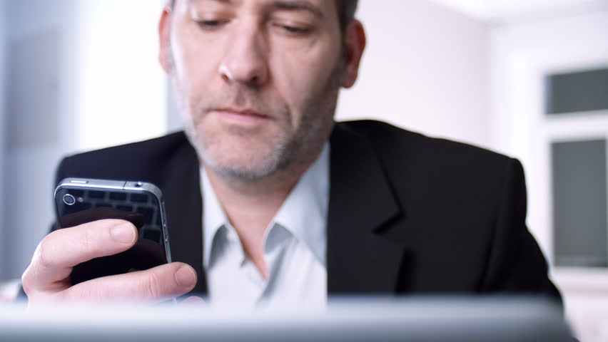 Businessman using his smart phone - tracking shot | Shutterstock HD Video #3450074