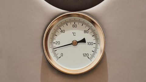 Thermometer on a water boiler rising