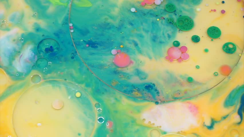 Abstract colorful bubbles marble background with milk oil and soap. Colored inks react to a drop of liquid soap in the oil. (fast motion)