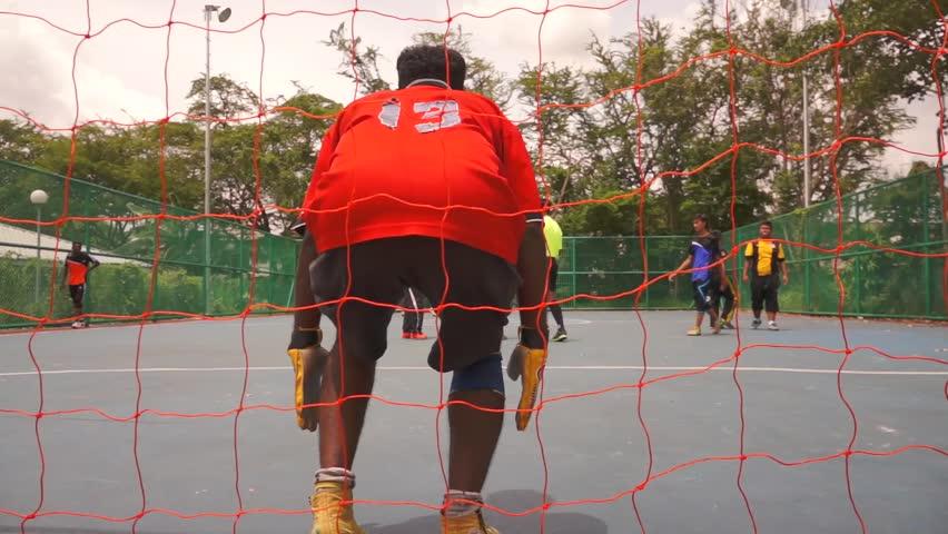 KUALA LUMPUR - FEB 24: Penalty kick during the neighborhood sports futsal competition in Taman Sri Rampai, Kuala Lumpur, Malaysia on Sunday, February 24, 2013.