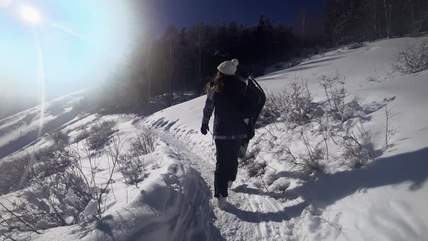 Footage of snowboarder woman adventure, walking to snowy alps mountains, Swiss. Snowboard and ski healthy activities, hiking #34610890