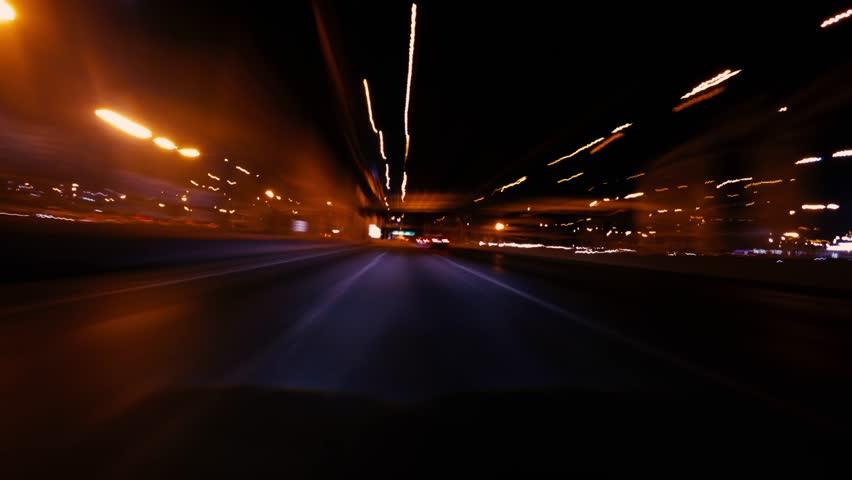 4K Timelapse - Long exposure shot of car moving on urban road at night. (POV #6)