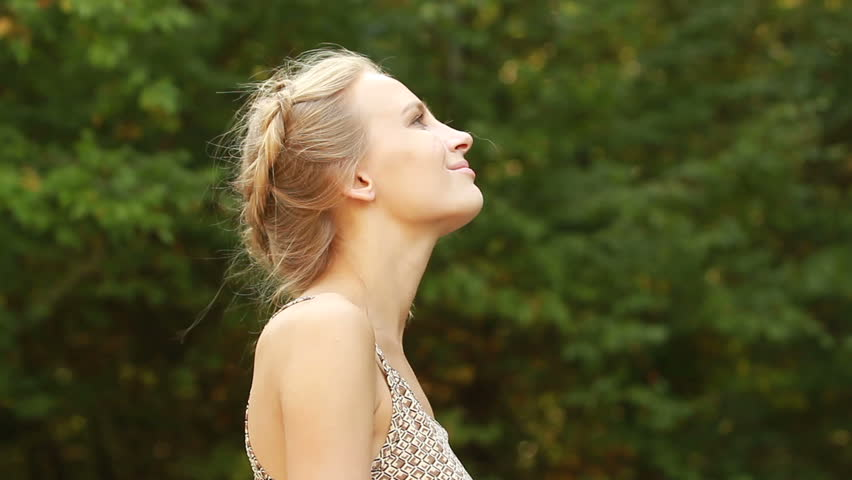 The girl breathes the freshness of the green forest | Shutterstock HD Video #34621870