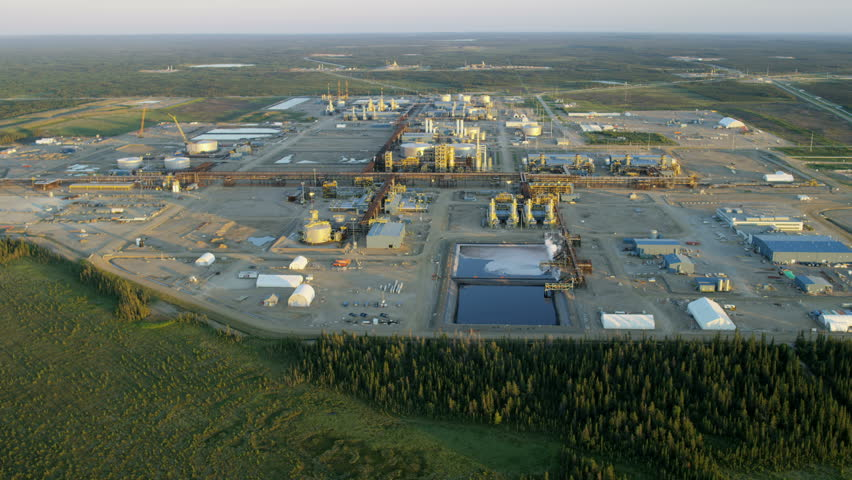 Aerial sunset view of a Commercial Oil Refinery site within Athabasca oil sands near Fort McMurray Northeast Alberta Canada RED WEAPON