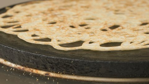 Cooking of pancake on a electric tile. Traditional russian pancake. Close up