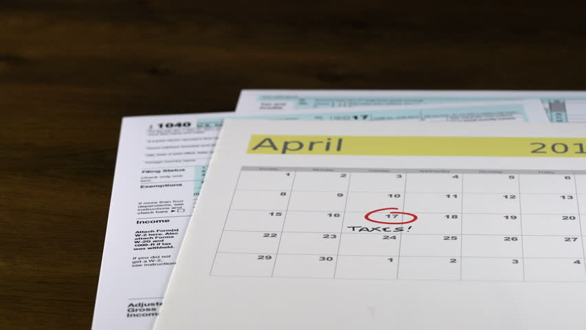 Calendar On Top Of Form 1040 Income Tax Form For 2017 Showing Tax