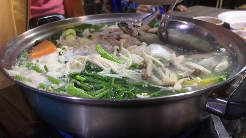 Sukiyaki concept. Boil vegetable mushroom and meat to sukiyaki for healthy food delicious. Sukiyaki is a Japanese dish that is prepared and served in the nabemono Japanese hot pot style.