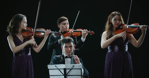 d845c249358e4 classical string quartet during the performance of the symphony